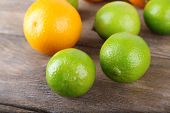 Ripe citrus on wooden background