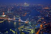 London rooftop view panorama at sunset with urban architectures and The Tower Bridge with Thames River at night