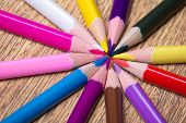 Close Up Of Many Colorful Drawing Pencils On Wooden Table