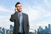 Portrait of a young businessman talking on the phone