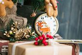 Watch With Toys Under The Christmas Tree