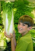 Boy Holding up Produce
