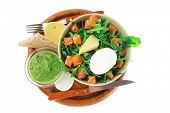 fresh green salad with smoked salmon in green bowl