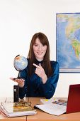 Geography Teacher Points A Finger At The Globe