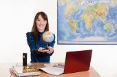 Young Employee Travel Company Stretches Hands Globe