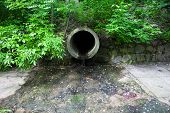 The Run-off Pipe Discharging Water