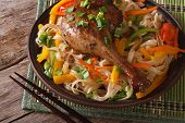 Duck Leg With Rice Noodles And Vegetables Closeup Horizontal