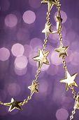 Christmas stars on sparkles background