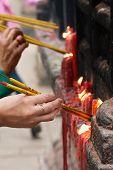 People Lighting Incense Sticks (1)