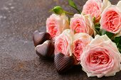chocolate candy hearts and pink roses for Valentine's day holiday