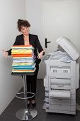 business woman using a copy machine