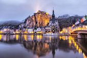 Church And Citadel Reflecting In River Meuse, Dinant