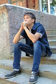 pic of pity  - Pensive Teenager on the landing steps of the House - JPG