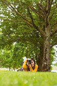 Portrait of female photographer at the park