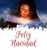 sexy santa girl opening gift against feliz navidad