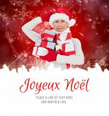 festive woman holding gifts against joyeux noel