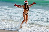 Santa Girl On The Beach In The Sea