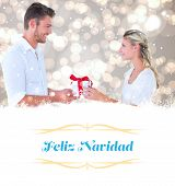 young couple with gift against Christmas greeting card