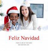 Business partners drinking to celebrates christmas against feliz navidad