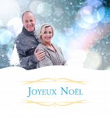mature winter couple against Christmas greeting card