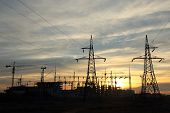 silhouette of construction and power lines at sunset
