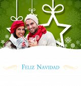 winter couple holding mugs against Christmas greeting card
