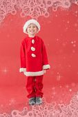 Cute little boy in santa costume against snowflake frame