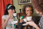 Smiilng Mature Women Having Tea