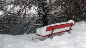 Red Bench Covered By Deep Snow