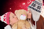 Mother and daughter kissing teddy against light design shimmering on red