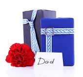 Two gift boxes with red carnation and card for Dad on white background
