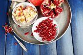 Juicy ripe pomegranates on wooden table