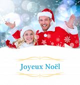 young festive couple against Christmas greeting card