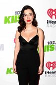 LOS ANGELES - DEC 5:  Christian Serratos at the KIIS FM's Jingle Ball 2014 at the Staples Center on December 5, 2014 in Los Angeles, CA