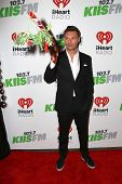LOS ANGELES - DEC 5:  Ryan Seacrest at the KIIS FM's Jingle Ball 2014 at the Staples Center on December 5, 2014 in Los Angeles, CA