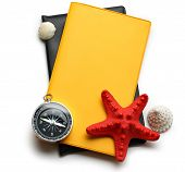 Compass, Seastar And Seashells On Notebook