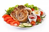 Barbecued steaks and vegetable salad