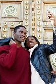 Dating couple happy in love taking self-portrait photo on beautiful antique door background