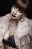 Glamorous vampire in the studio, close-up portrait