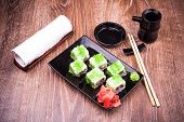 Sushi Roll Set In Green Caviar With Ginger, Soy Sauce, Towel And Chopsticks