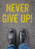 Text on the floor - Never give up