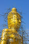 Buddha Image Reparation On The Blue Sky