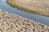 Small Stream And Sand