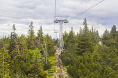 cableway leading to the mountain in the Czech Republic Sn??ka on the background of spruce forest