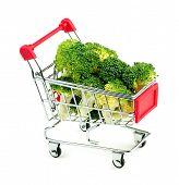 Studio Shot Of Freshly Cut Green Broccoli In Mini Shopping Trolley