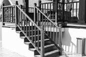 foto of bannister  - shadow of the bannister on wooden stair step - JPG