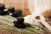 picture of swedish sauna  - detail of aromatic salt for spa treatment and basalt stones on bamboo mats - JPG