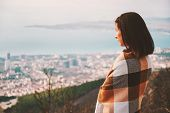 Woman Wrapped In Plaid Looking At The City In Autumn