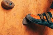 Man's Foot On Climbing Wall