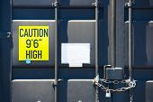 Locked container door with chain